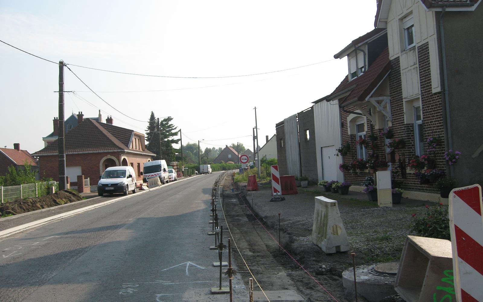 travaux pose de bordure aménagement paysager rue de robecq